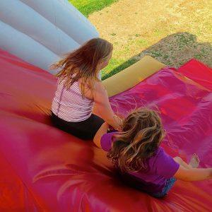 Slip sliding away on bouncy castles in Newquay.