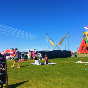 Red arrows flying over Body Bounce bouncy castles in Newquay